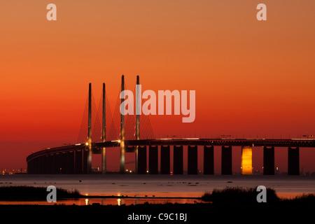 The bridge between Copenhagen Denmark and Malmo Sweden in sunset over Oresund. The region of Oresund is an great - Stock Photo