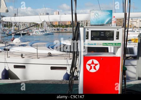 Large yacht a marina petrol station in Spain - Stock Photo