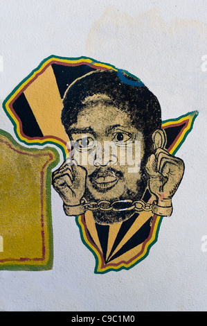 Graffiti with African continent and handcuffed African on the campus of the University of Cape Town South Africa - Stock Photo