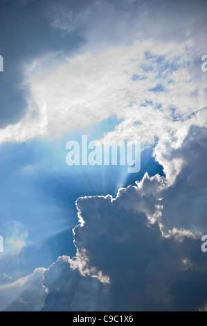 Sun Burst Angel Rays Through Clouds - Stock Photo