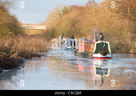 Two narrowboats breaking ice on the Kennet & Avon Canal Nr Newbury - Stock Photo