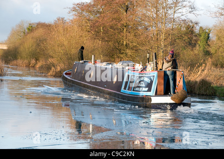 A narrowboat breaking ice on the Kennet & Avon Canal Nr Newbury - Stock Photo