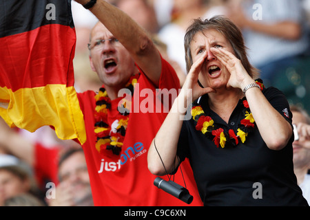 Germany supporters cheer their team at the 2011 FIFA Women's World Cup Group A match between France and Germany. - Stock Photo