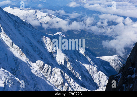Chamonix valley from the Aiguille du Midi summit cable car station, looking West - Stock Photo