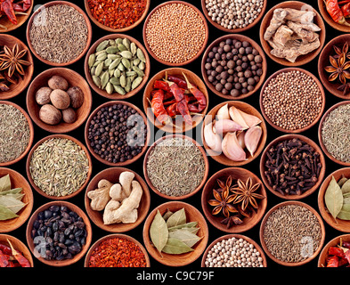 Seamless texture of spices on black background - Stock Photo