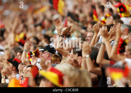 Germany supporters clap during a 2011 Women's World Cup Group A match between France and Germany at Stadion im Borussia - Stock Photo