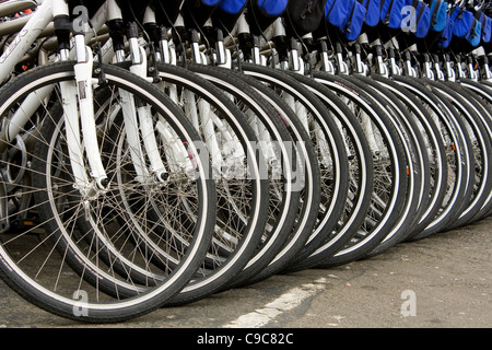 Several mountain bikes lined up on a street ready to be used by tourist in San Fransisco close to the Piers - Stock Photo