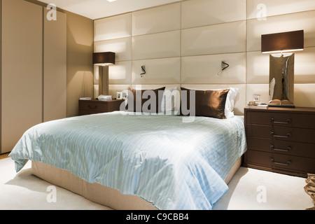 Contemporary Bedroom Interior in London Apartment - Stock Photo