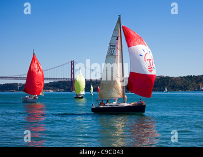 Sailing on the River Tagus with the Ponte 25 de Abril Bridge in background - Stock Photo