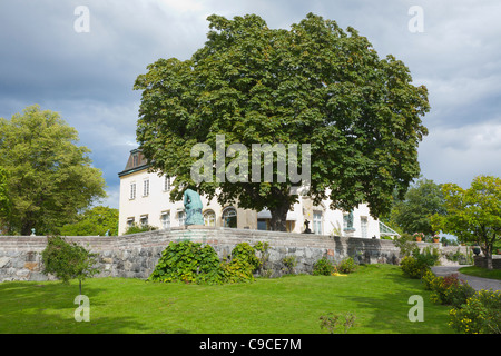 The museum at Waldemarsudde with a big chestnut tree in front, Stockholm, Sweden - Stock Photo