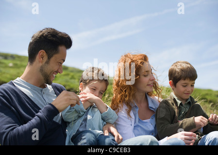 Parents and young boys playing in nature - Stock Photo