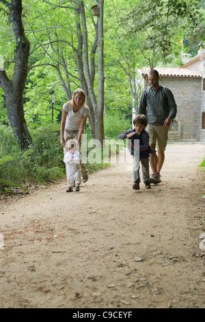Family hiking in woods - Stock Photo