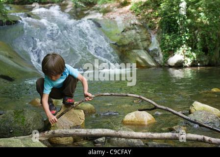 Young boy exploring nature - Stock Photo