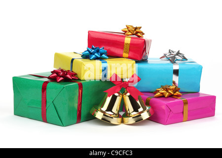 Christmas gifts with jingle bell isolated on white. - Stock Photo