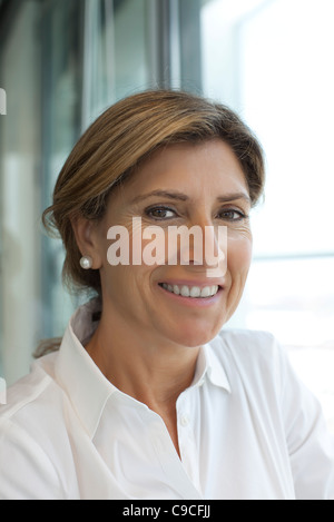 Businesswoman smiling, portrait - Stock Photo