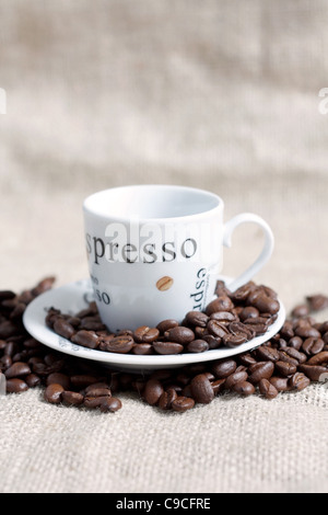 Coffee beans and a cup of coffee - Stock Photo