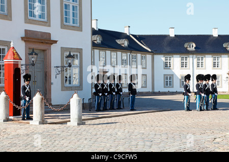 Bearskin sentries from the Royal Life Guards at the change of guards at the Fredensborg Palace near Copenhagen, - Stock Photo
