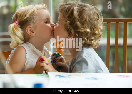 Little boy and girl kissing - Stock Photo