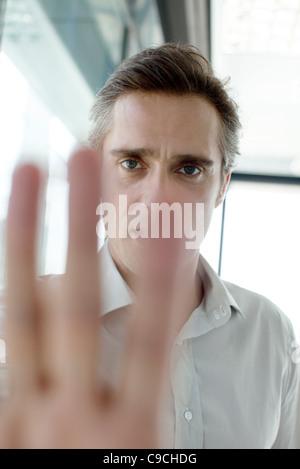 Man in dark, backlit - Stock Photo