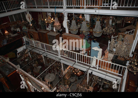 Array of items on sale in an indoor antiques market in Brussels - Stock Photo