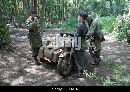 German World War 2 re-enactors with a German BMW R75 motorcycle with sidecar at the 2011 War & Peace Show, Hop Farm, - Stock Photo