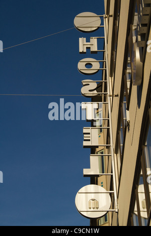 Vertical Hostel sign from behind against blue sky - Stock Photo
