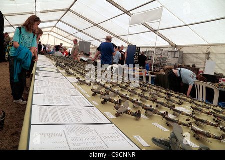 Tables of miniature Spitfire & Hurricane model aircraft on sale at the 2011 War & Peace Show at Hop Farm, Kent, - Stock Photo