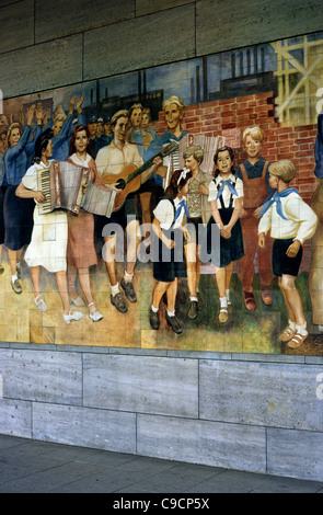 Historic East German communist mural on a wall of Detlev-Rohwedder-Haus, the Federal Ministry of Finance in Berlin. - Stock Photo