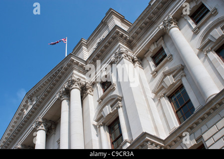Abstract view of London building with union flag flying against blue background. - Stock Photo