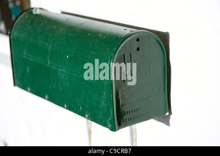 Green US Mail box. on White wall - Stock Photo