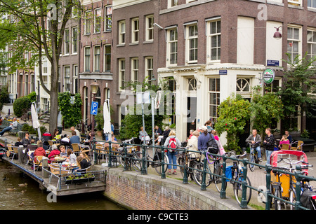 The populat cafe 't Smalle, a canalside bar in Jordaan just off the Prinsengracht, Amsterdam, The Netherlands - Stock Photo