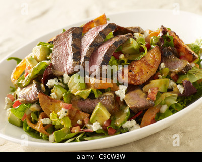 Grilled steak and potato salad - Stock Photo