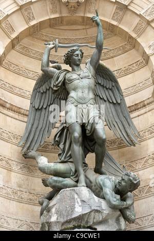 St Michael striking down the dragon, Paris - Stock Photo
