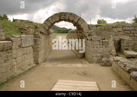 Greek Art. Sanctuary of Olympia. Olympic stadium. The vaulted tunnel leading out of the stadium. Hellenistic period. - Stock Photo
