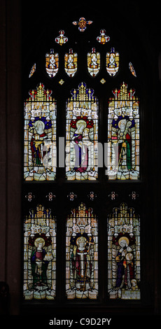 Stained glass window by John Charles Bewsey depicting various saints - Stock Photo