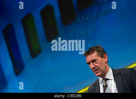 Jim O'Neill, Chairman of Goldman Sachs Asset Management speaks at a London business conference - Stock Photo