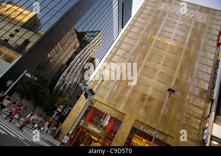 Japan, Tokyo, Ginza, Golden facade of the Cartier Building with the Chanel Building on left and De Beers curved - Stock Photo