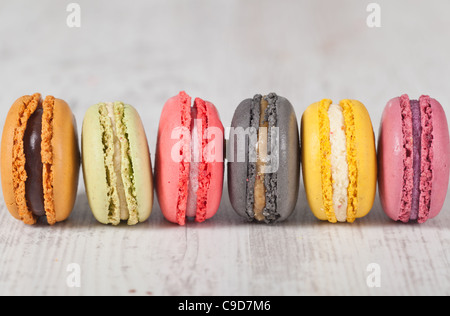Colorful delicious macarons, typical french pastries - Stock Photo