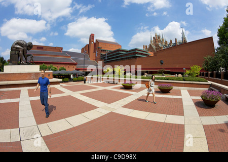 British Library Courtyard with statue of Isaac Newton, with St Pancras Railway Station behind, Euston Road, London, - Stock Photo