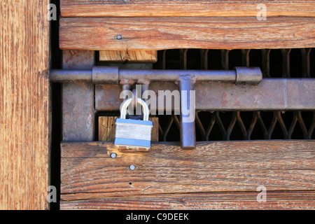 ... padlocked wood and metal door with heavy duty hasp - Stock Photo & padlocked door Stock Photo Royalty Free Image: 4679856 - Alamy Pezcame.Com