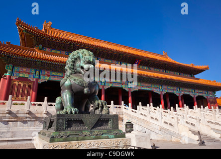 Male bronze lion, Gate of Supreme Harmony, Outer Court, Forbidden City, Beijing, Peoples Republic of China, Asia - Stock Photo