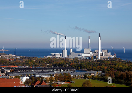 Aeriel view over combined heat and power plant Amagerværket in Copenhagen - wind turbine park outside the port of - Stock Photo