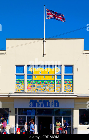 Entrance to Southwold Pier in Suffolk England with Union Jack flag flying on the roof - Stock Photo