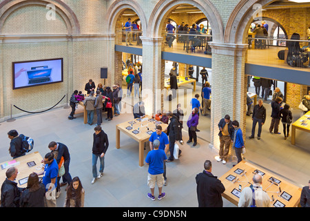 Large open plan Apple store in Covent Garden London UK - Stock Photo