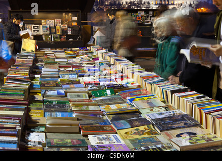 The open air secondhand book sales on the South Bank London before Christmas at dusk - Stock Photo