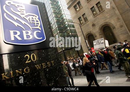 Toronto Ontario, Canada - November 24, 2011. Protestors from Occupy Toronto, London, Kingston and Ottawa join Ontario - Stock Photo