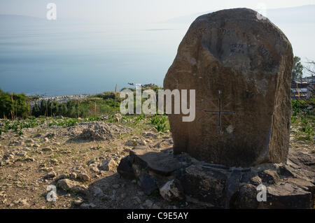 Rocks symbolizing the blessings, or beatitudes, are spread out on a cliff overlooking the Sea of Galilee just below - Stock Photo