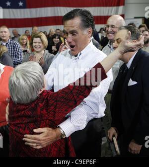 Dec. 9, 2011 - Cedar Rapids, Iowa, U.S. - JONI SCOTTER hugs Republican presidential candidate MITT ROMNEY before - Stock Photo