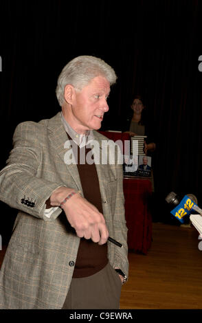 Portrait of President Bill Clinton as he speaks to the press during book signing event for Back to Work at his hometown - Stock Photo
