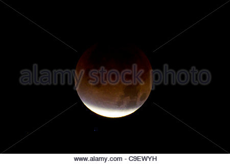 The moon, viewed from Seattle, Washington, turns red as the Earth passes between it and the sun. The December 10, - Stock Photo
